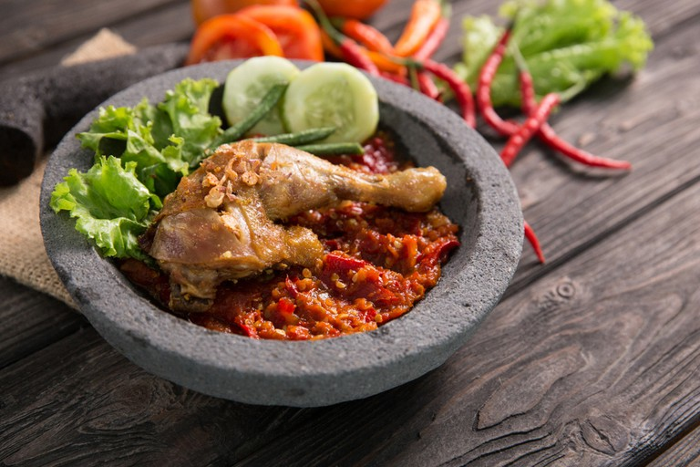 Ayam penyet traditional spicy sauce or sambal and fried chicken