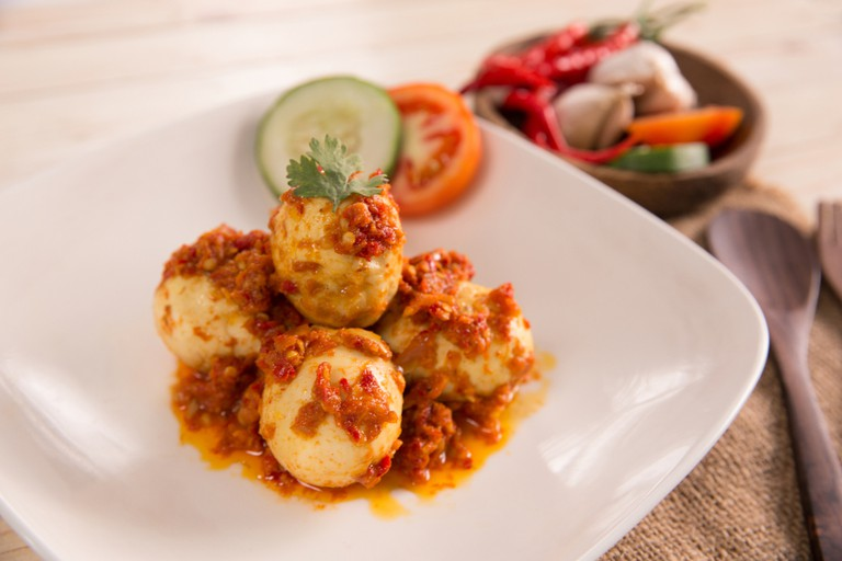 Telur balado, boiled egg served with tomato and chili paste, or sambal.