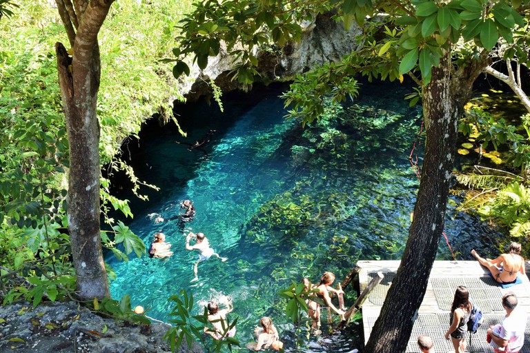 People who enjoy Grand Cenote in Tulum, Mexico.