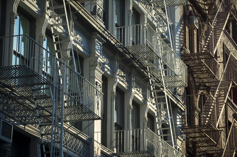 Architectural detail view of cast iron fire escapes in New York City