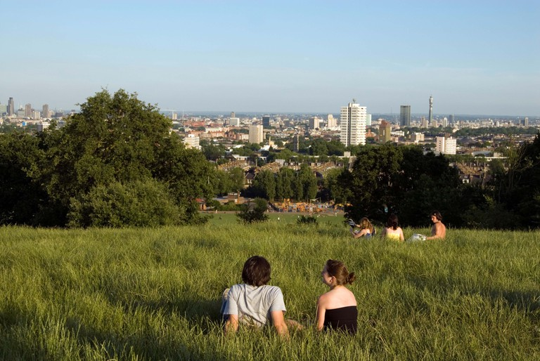 People enjoying the view at Hampstead Heath, London, England, UK