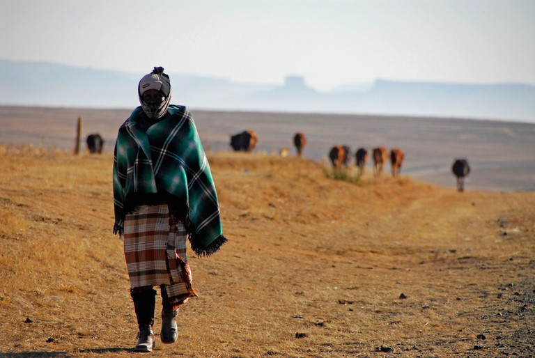 Basotho woman wrapped in blanket to keep out bitterly cold weather in Lesotho, Africa.