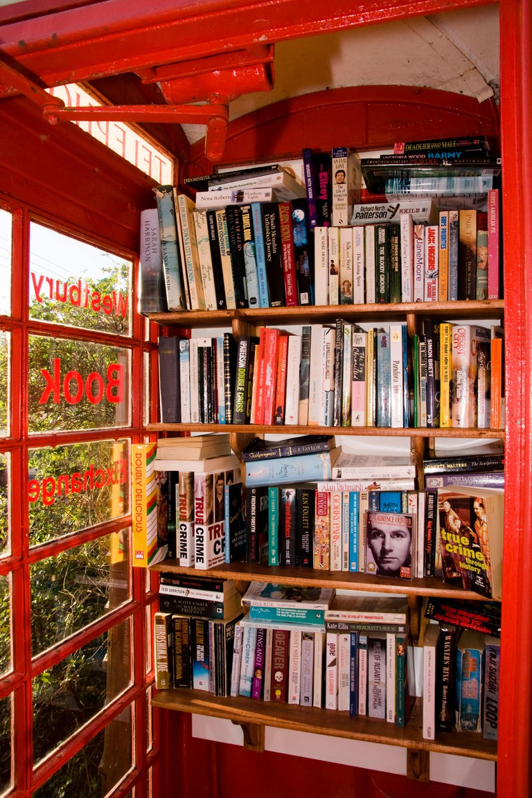 Traditional red telephone box recycled into one of the country's smallest lending libraries