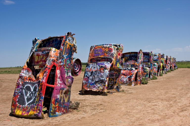 World famous Cadillacs stand guard just west of Amarillo, Texas. This roadside attraction is a recognized pop art treasure.