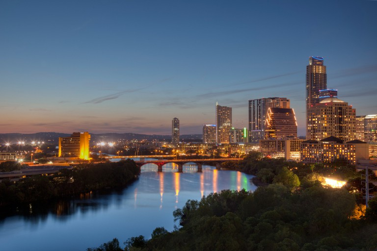 Looking down Lady Bird Lake to the west, with the view of the Austin Skyline and Congress Bridge on the horizon.