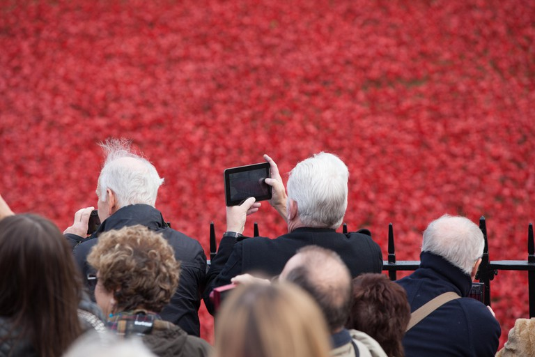 Members of the pubic viewing the Tower of London poppies installation on 6th November 2014