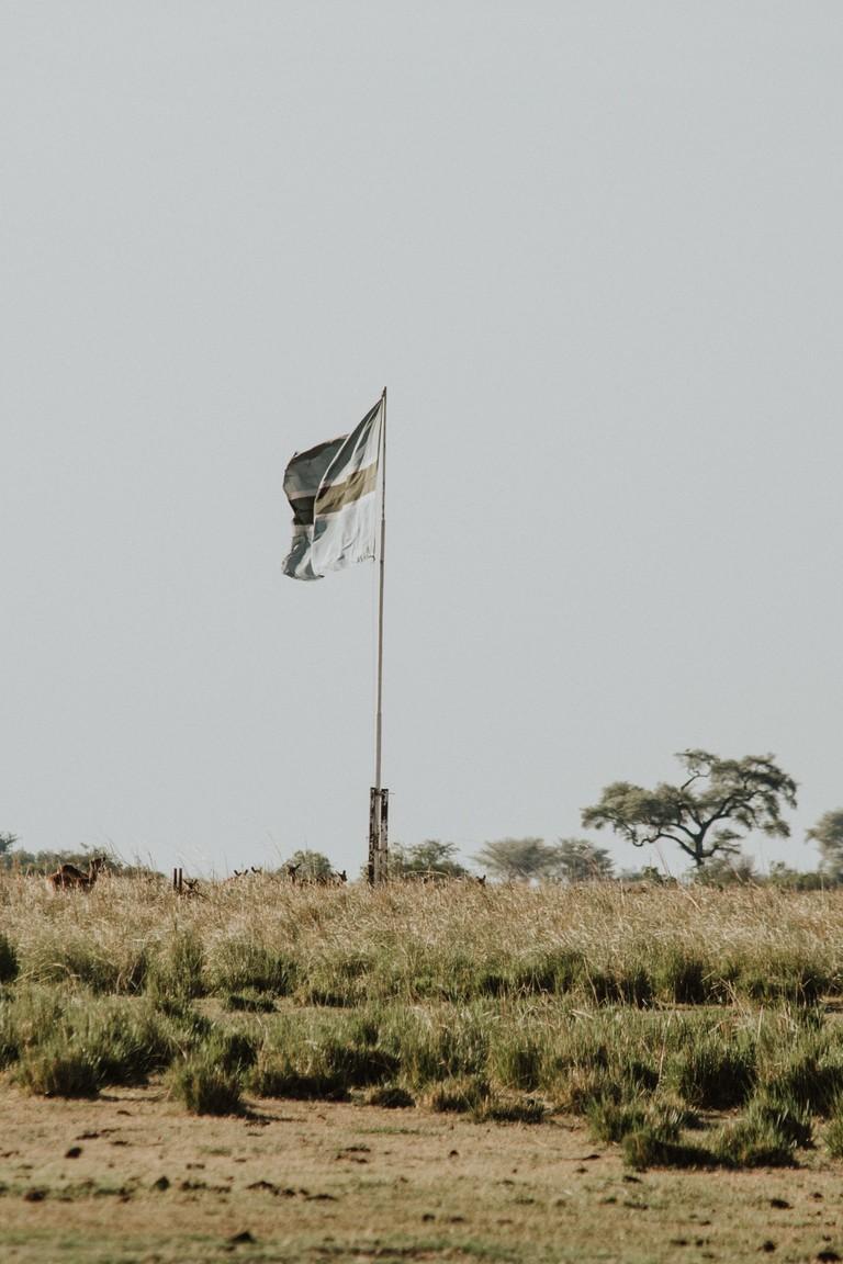 The Botswana flag flies high on Sedudu Island in Chobe