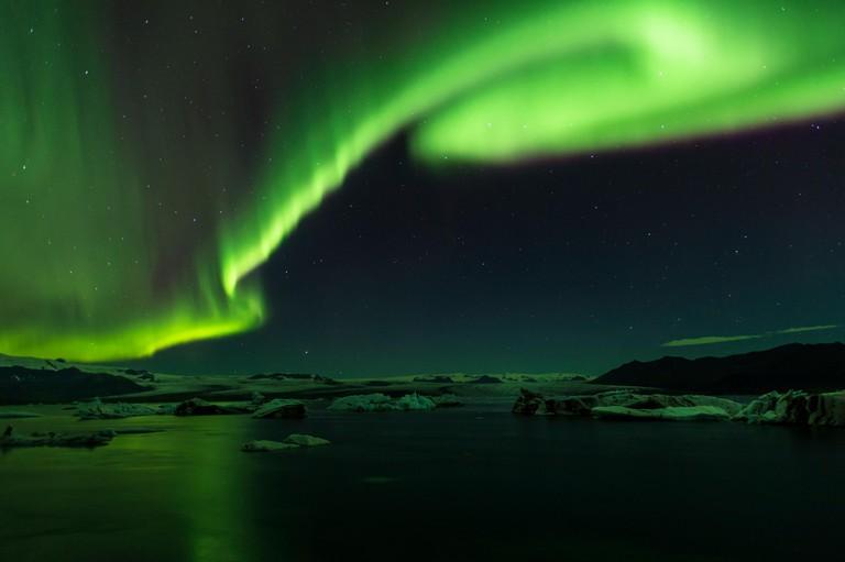 Aurora display above Jokulsarlon Iceberg Lagoon, Vatnajokull National Park, Iceland.