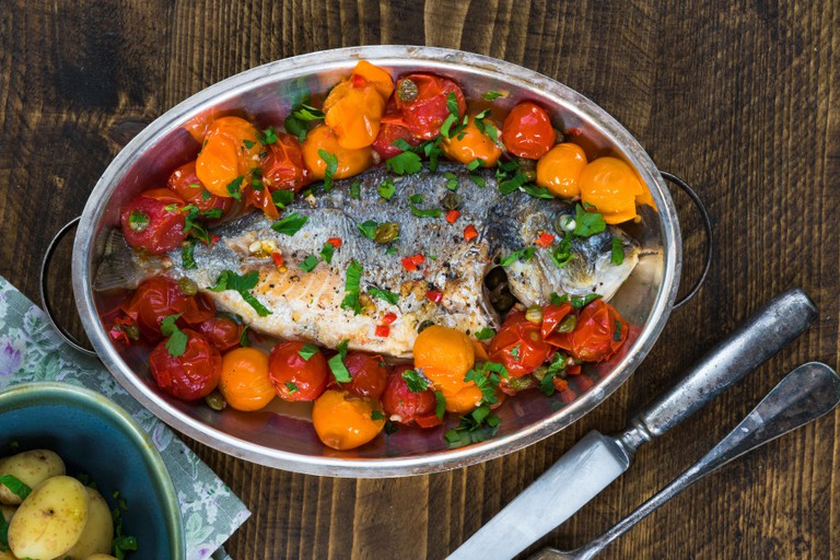 Italian style sea bream in water