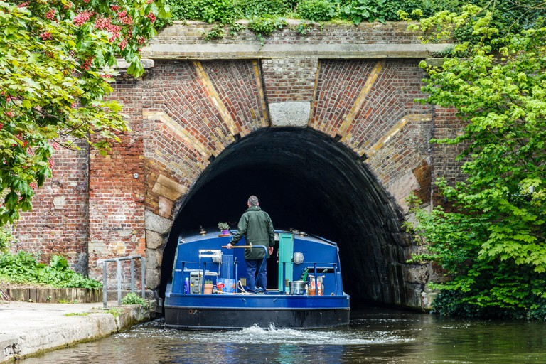 Narrowboat negotiating Regent's Canal, London.
