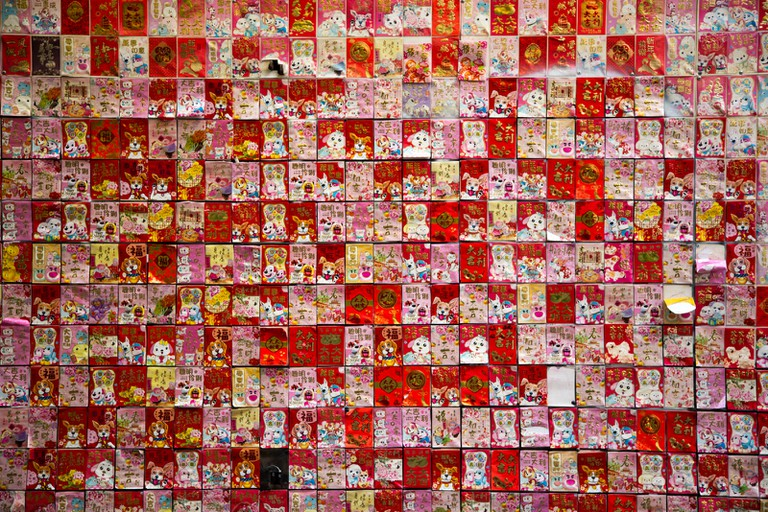 Red envelopes are stuffed with money and given as gifts on special occasions for good luck and prosperity