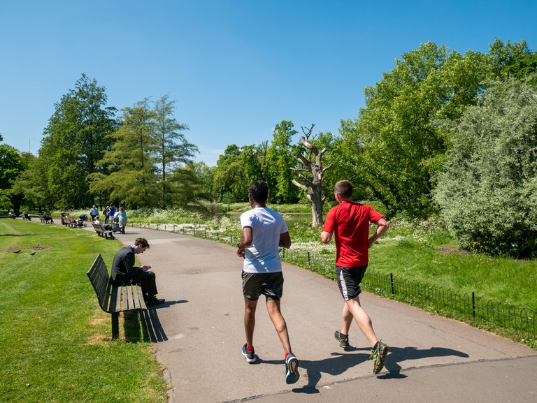 Joggers running at Regent's Park, London.