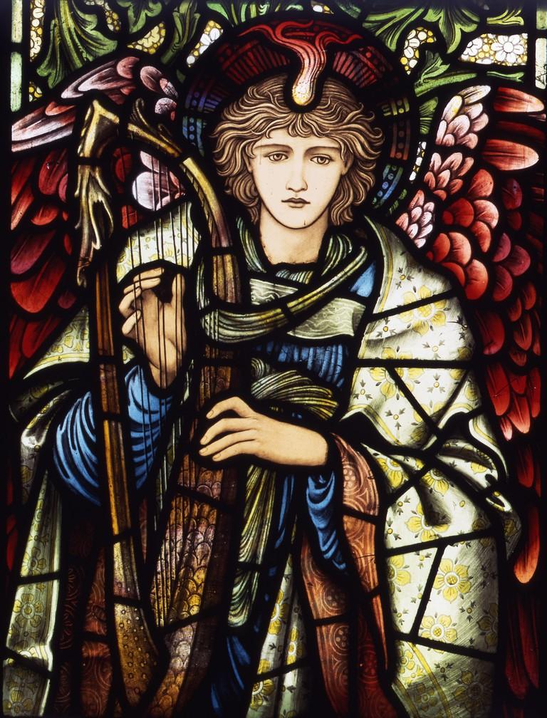 Praising Angel stained glass by Edward Burne-Jones (1902)