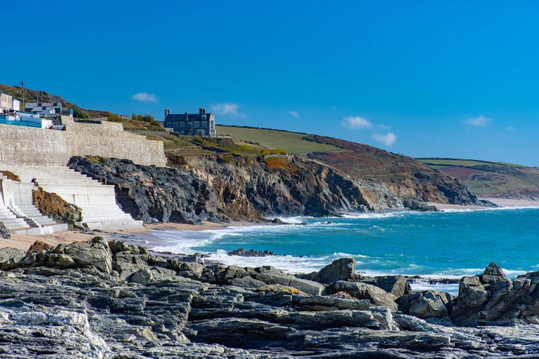 building on a cliff in the village Porthleven in late summer which is known for the big dangerous winter waves in South Cornwall