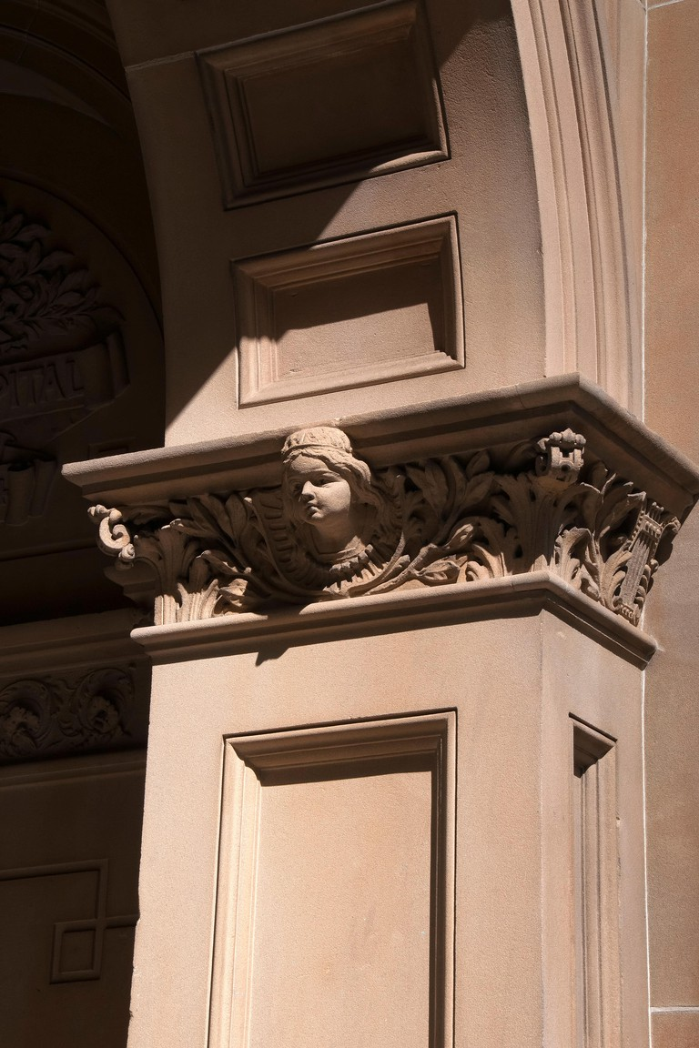 Sydney Australia, Sydney Hospital entrance, arch with sandstone decoration of an angel or girl