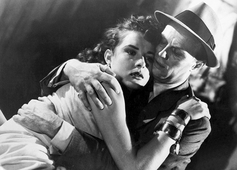"Jean Peters and Richard Widmark in ""Pickup on South Street"""