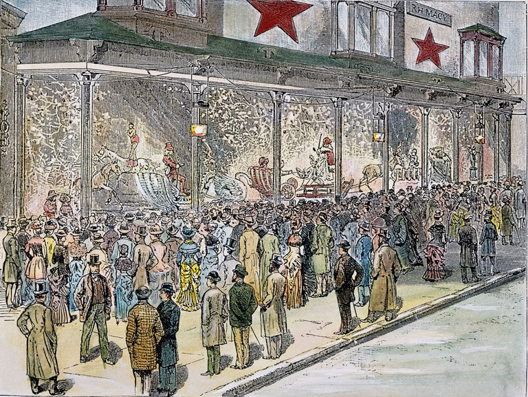 Crowds outside Macy's at Sixth Avenue and 14th Street in New York, viewing the spectacularly decorated holiday windows. American engraving, 1884
