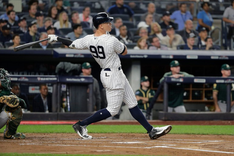 New York Yankees' Aaron Judge hits a two-run home run during the first inning of the American League wildcard playoff baseball game against the Oakland Athletics, in New York, USA - 03 Oct 2018