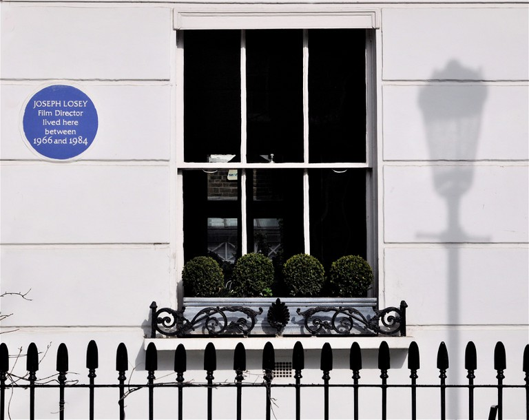 Commemorative blue plaque for film director Joseph Losey, on a house in Chelsea, London.