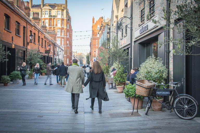 People walking on Pavilion Street in Knightsbridge, close to Sloane Street and Kings Road Chelsea.