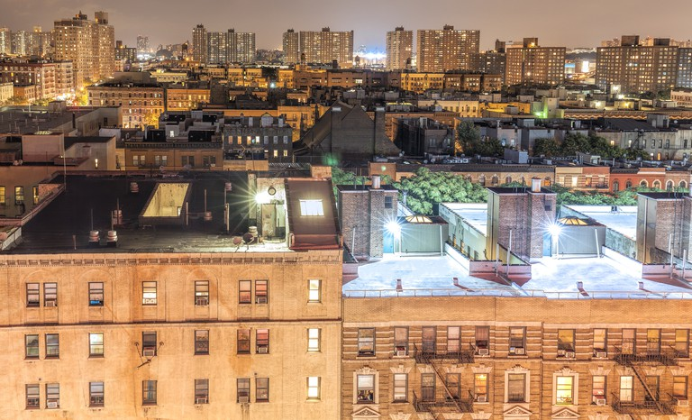 No NYC neighborhood has a richer cultural history than Harlem, seen here at night