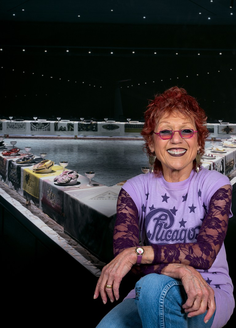 Judy Chicago in front of The Dinner Party, 2017.