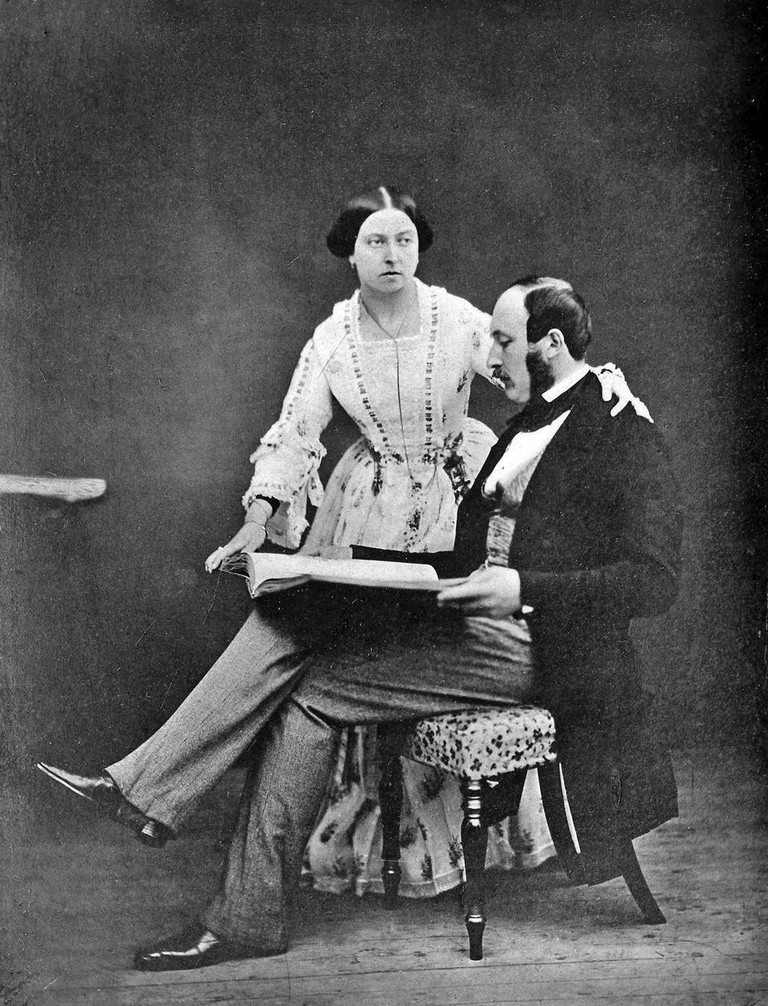 Queen Victoria and Prince Albert looking over a book in 1854