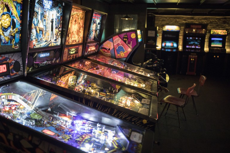 Tilt ball machines at Barcade in Williamsburg, Brooklyn, New York.