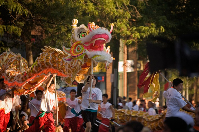 Chinese Dragon team performs in Chinatown International District Seafair parade, Seattle