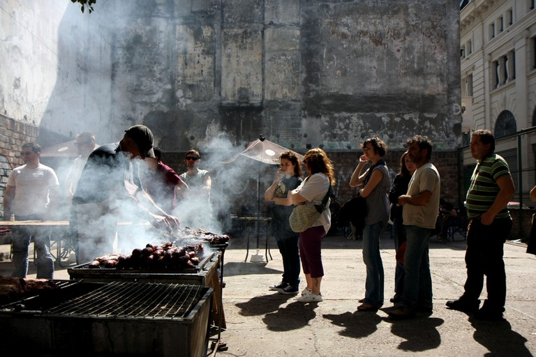 People wait in a line for barbecue meat in Buenos Aires