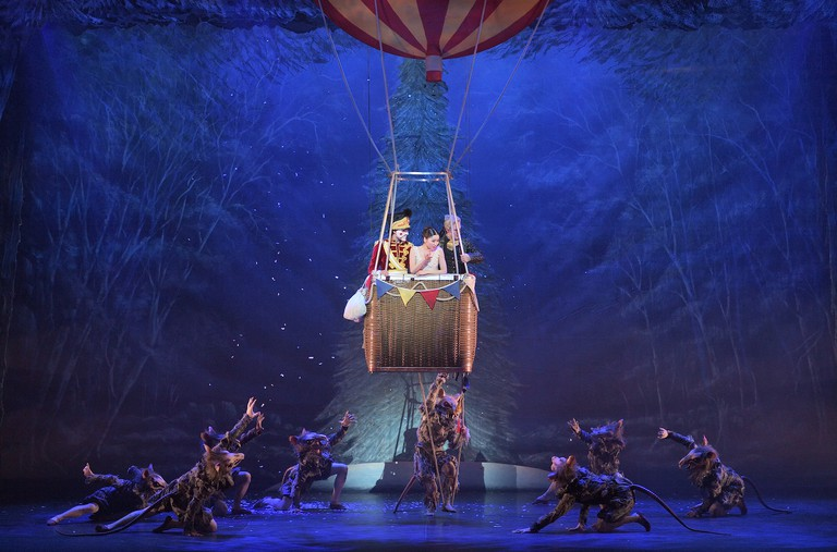 Clara, the Nutcracker and Drosselmeyer escape in a hot air balloon to the Land of Snow