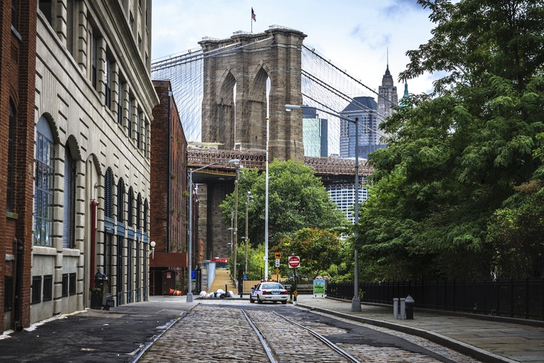 View of Manhattan Bridge from a Brooklyn street in the neighborhood known as DUMBO.