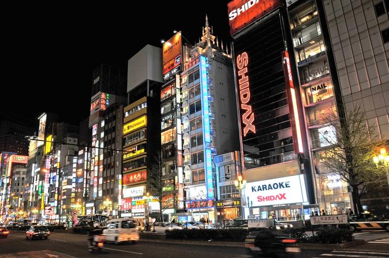 street scene by night Shinjuku Tokyo Japan