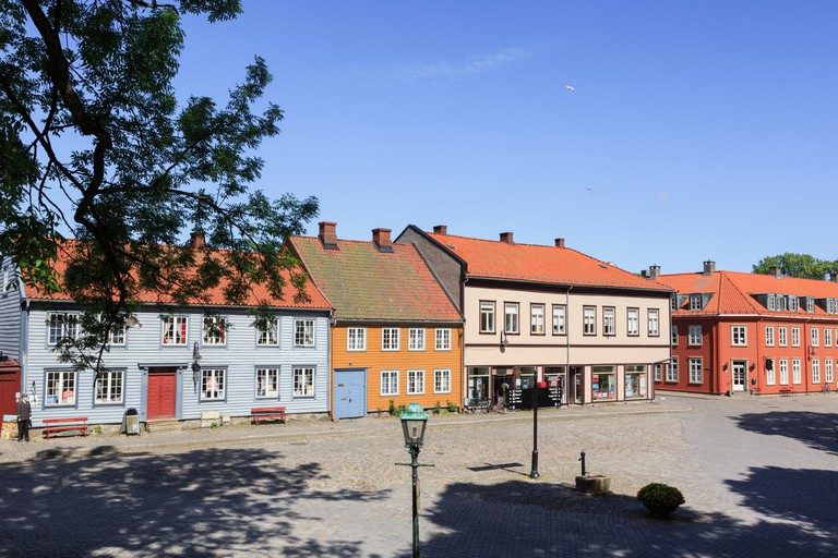 Traditional historic wooden buildings on Voldgarten in old town of Gamlebyen, Fredrikstad, Norway.