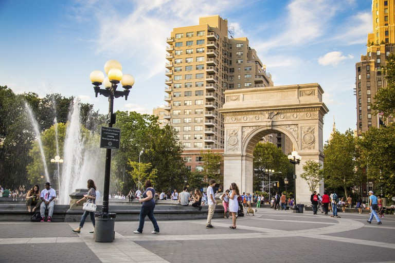 View of Washington Square Park in New York City with visitors present on Aug. 15, 2013
