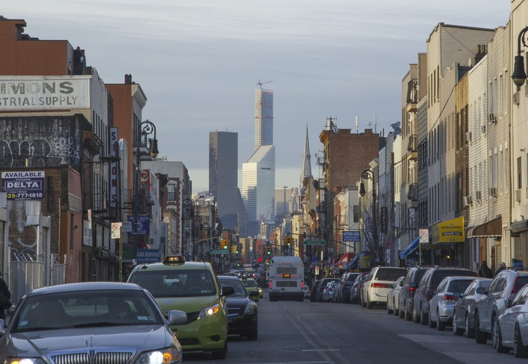 Manhattan office towers and luxury condos loom on the horizon as you head north on Greenpoint's Manhattan Avenue