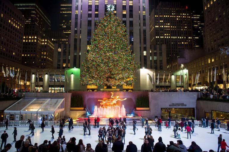 Ice skaters fill the skating rink under the Rockefeller Center Christmas tree, New York City.