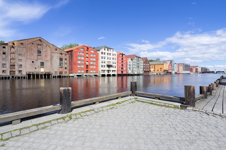 Old storehouses flanking the river Nidelva in Trondheim, Norway.