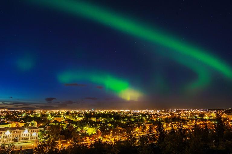 Northern Lights over suburb of Reykjavik, Hafnarfjordur, Iceland.