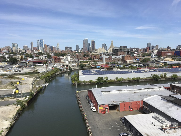 Looking northeast over Brooklyn with the Gowanus Canal in the foreground and downtown Brooklyn on the horizon.