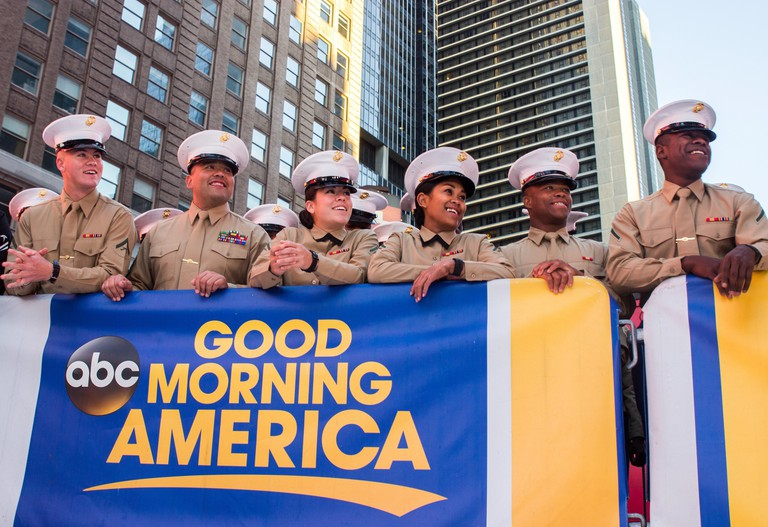 Marines wait for their chance to be seen on the ABC Good Morning America television show at Times Square in New York City, N.Y., Nov. 11, 2016. Marines from local units are participating in Veterans Week New York City 2016 to honor the service of all our