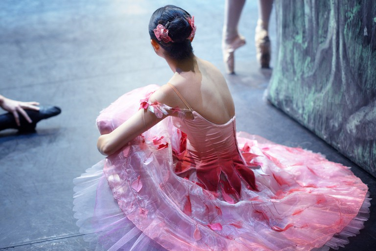 A dancer prepares to take to the stage for the 'Waltz of the Flowers'