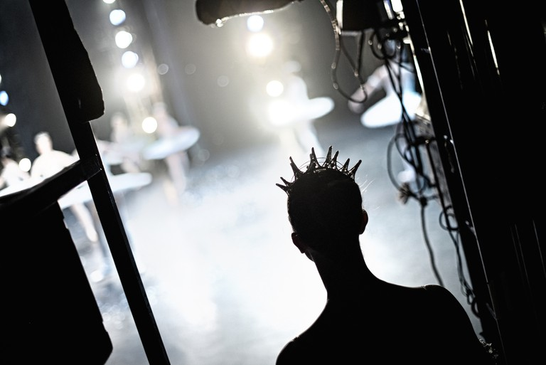A dancer in the 'Nutcracker' waits in the wings