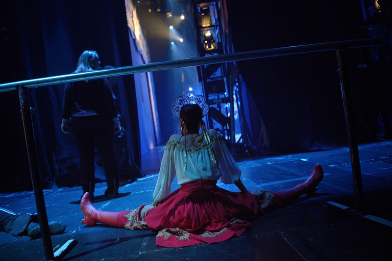 One of the Russian dancers stretches before her scene