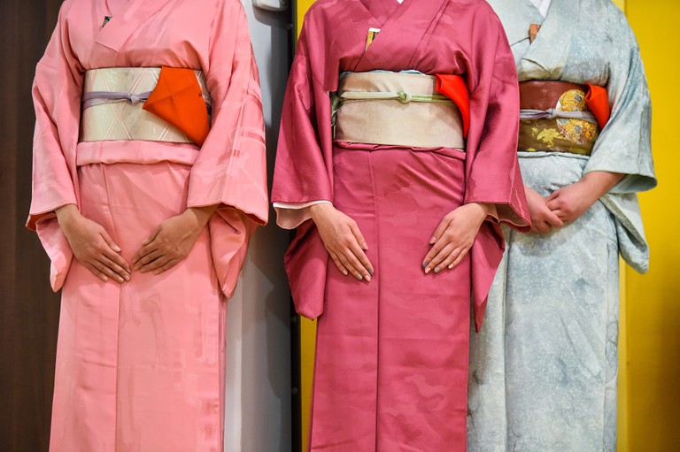 People don traditional kimono during a tea ceremony