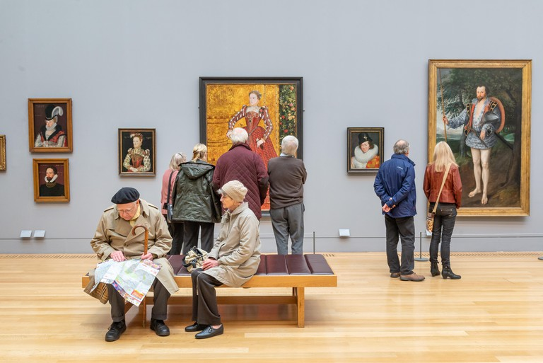 Visitors looking at 16th century art in Tate Britain, London, UK