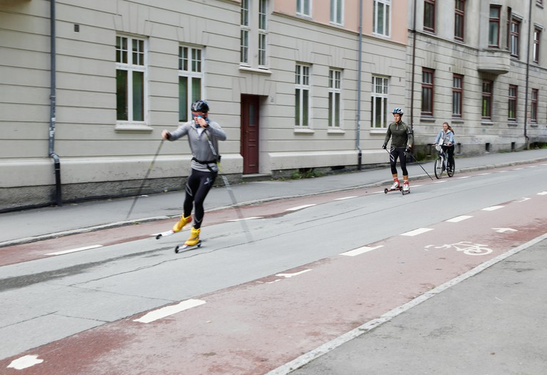 Two males on rollerskis in Trondheim, Norway