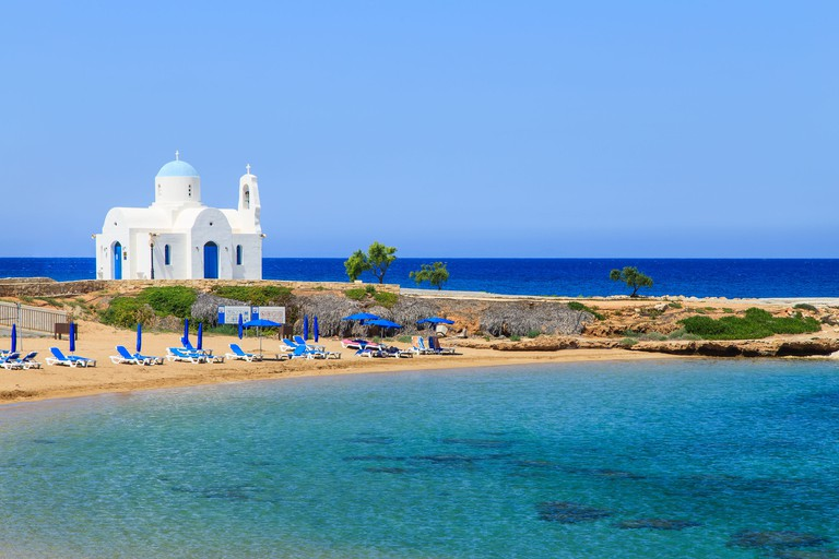 White church on a shore in Protaras, Cuprus.