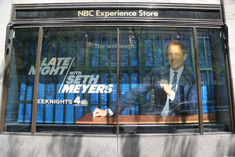 NBC Experience Store window display decorated with Late Night with Seth Meyers logo in Rockefeller Center in Midtown Manhattan.