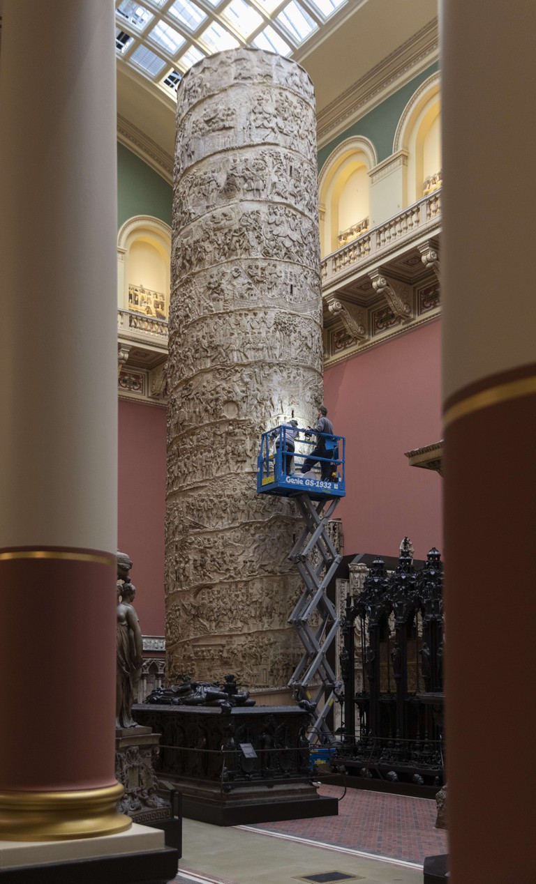Conservationists work on Trajan's Column in the Cast Courts